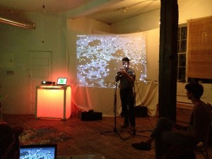 Ellwood Epps playing at Empty Sets, while a guest takes over an installation (bottom left and projection).