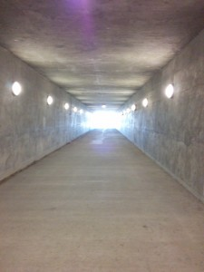 Colorado's infrastructure is highly developed. This roomy and well-lit tunnel allows pedestrians and cyclists to cross under highways. Also, the ball of light bursting from these four walls represents the pure productive energy emanating from my cubicle.