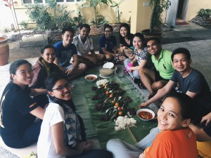 AHRC Interns taking part in a Boodle Fight