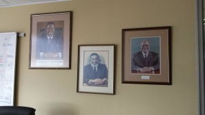 Pictures of Namibia's three Presidents hang in the boardroom of the Law Reform and Development Commission. President Hage Geingob is pictured on the left.